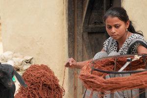 Armadillo & Co preparing the yarn for the rugs. Photo courtesy of Armadillo & Co